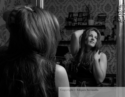 Beautiful woman in front of a mirror