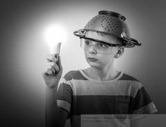 boy with a lighted bulb