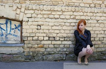 image with woman at the brick wall