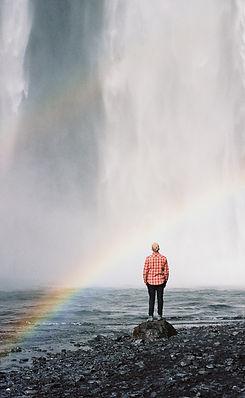Man-near-the-waterfall-588975132_2003x15