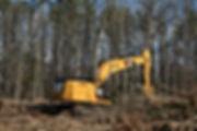 Track Hoe grubbibg removing trees