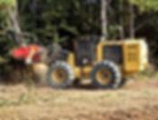 Mulcher grinding trees