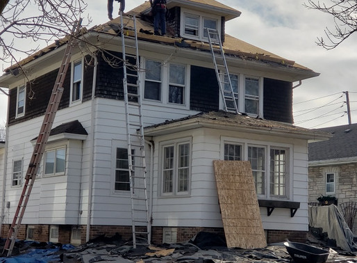 The roof is LITERALLY being blown off of this Wauwatosa home!