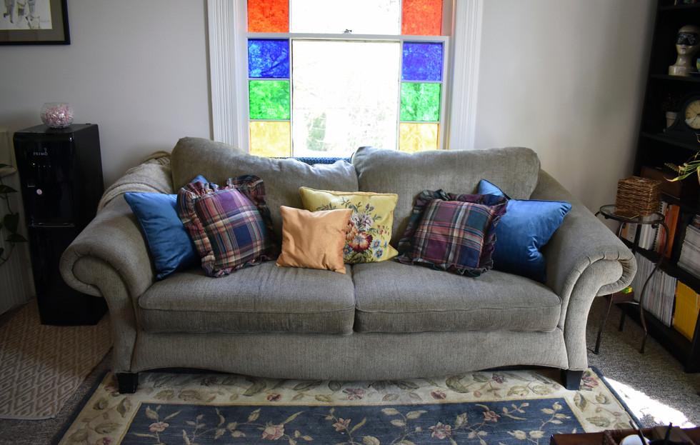 Inside, cozy seating is backed by 19th century German stained glass
