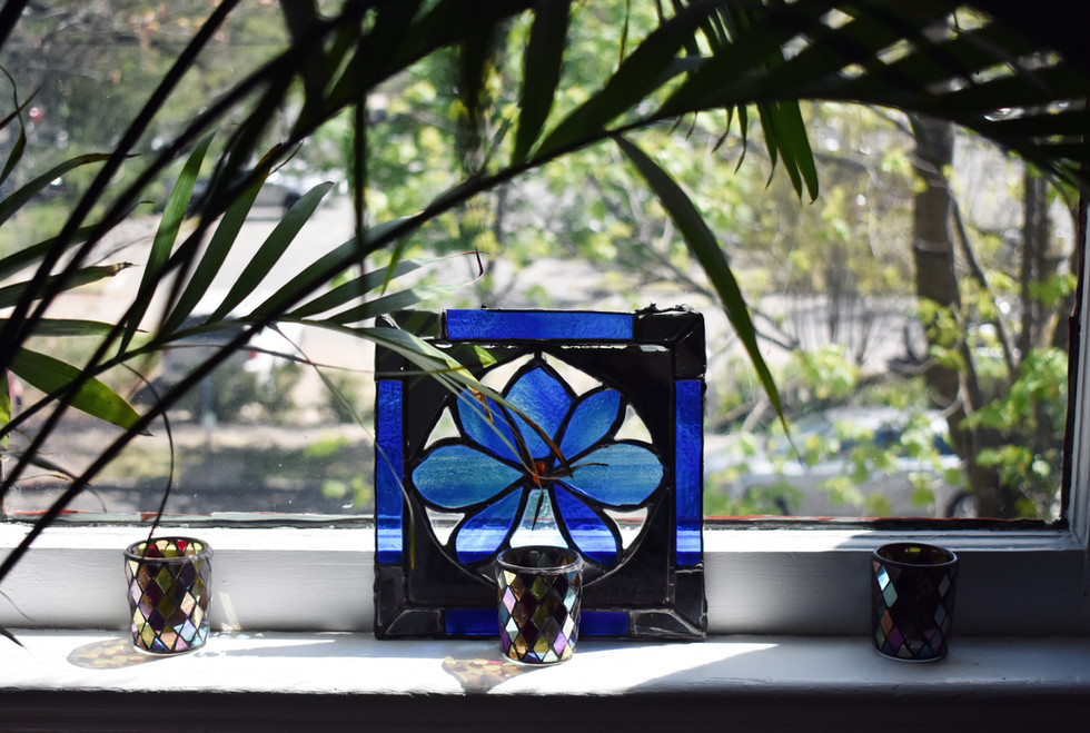 Arching leaves and stained glass frame a second floor view