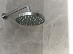 Chrome shower head bathroom renovation