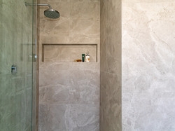 Textured grey shower area