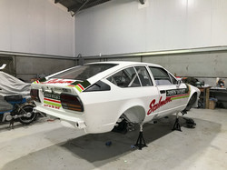 Alfa GTV6 being sign written and stickers applied