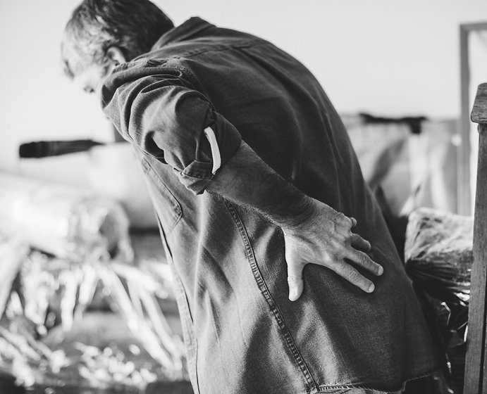 older man experiences lower back pain