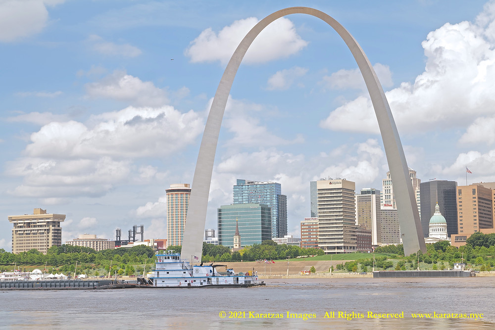 Picture of Towboat MV 'John Grimsley #59' sailing downstream by the Gateway Arch, St Louis, MO.