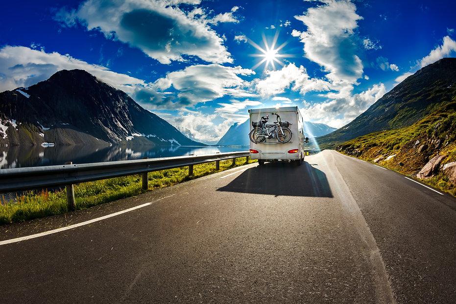 Caravan car travels on the highway. Tour