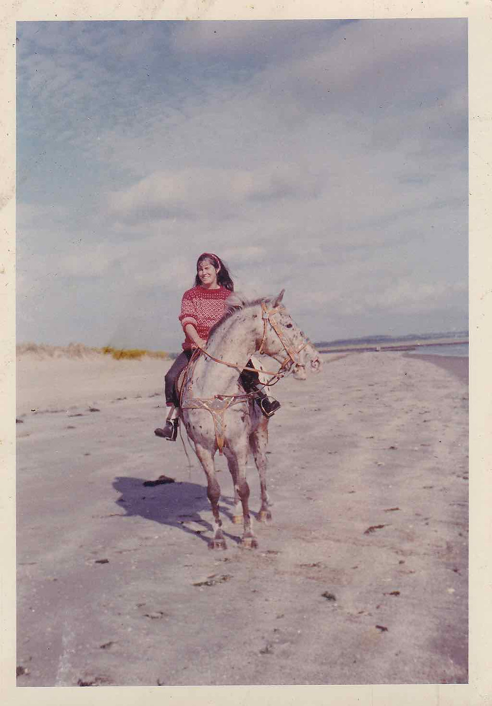 Juanita Casey on Texas riding on Mornington Strand in Ireland. One of her short stories has just been republished.