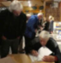 Artist Alan Langford an author Christopher Charman signing his memoir