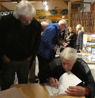 Artist Alan Langford an author Christopher Charman signing his memoir