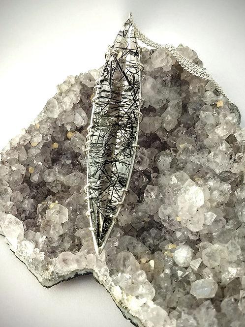 Rutalated quartz pendant