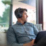 bbpro_headset_man_couch_laptop.jpg