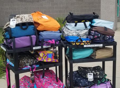 Generous Dems Donate Backpacks for Kids!