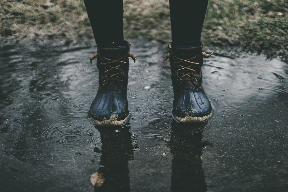 standing in a puddle