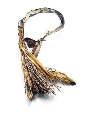 Emerging, a tamale