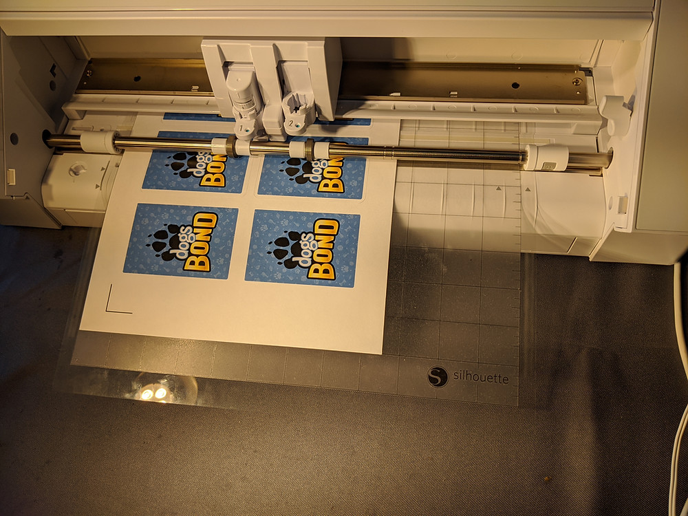 Dogs BOND test print being cut on a CAMEO cutting machine