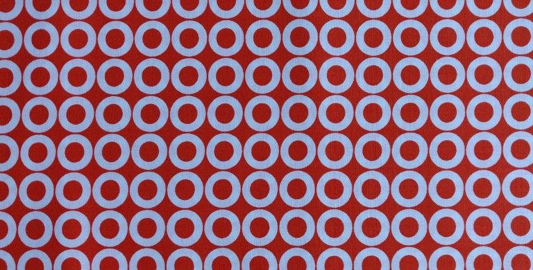 Circles on orange fabric by Robert Kaufman
