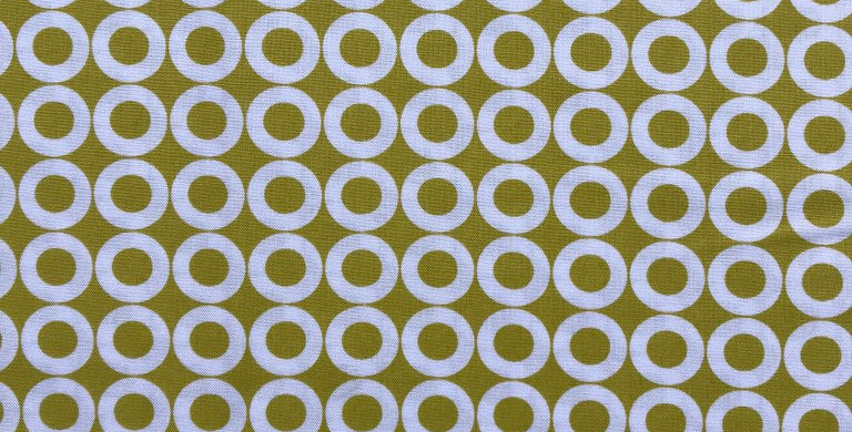 Circles on cactus lime fabric by Robert Kaufman