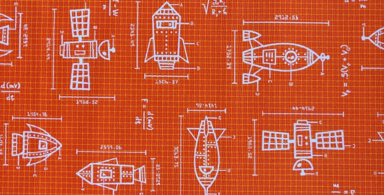 Space Out Rockets orange fabric by Robert Kaufman