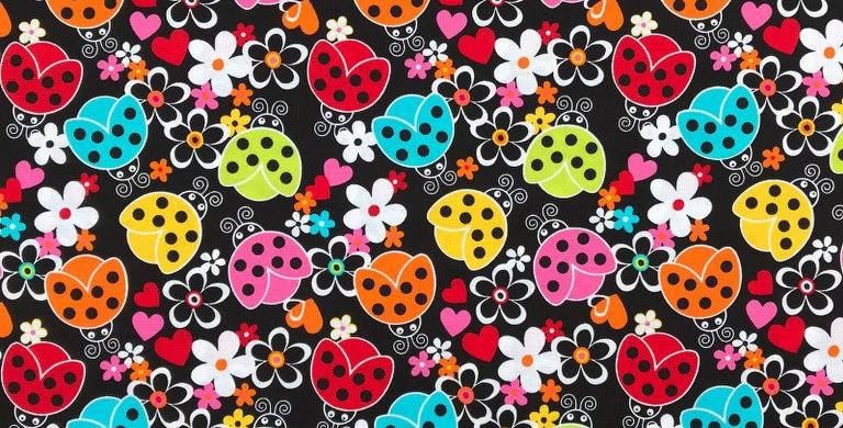 Ladybugs / Ladybirds black fabric by Robert Kaufman