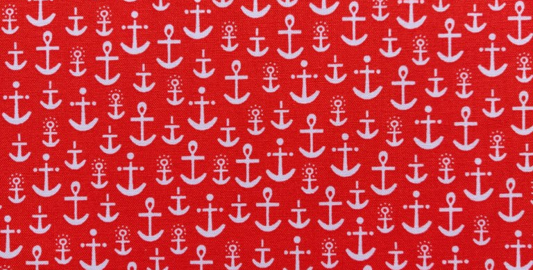 Nautical Message in a Bottle Anchors orange fabric by Robert Kaufman