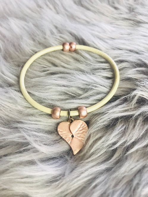 Rose gold heart on leather bracelet