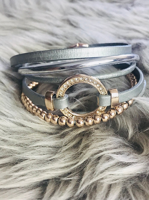 Multi strand leather bracelet with crystal circle