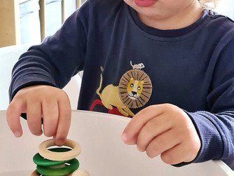 Peg doll and rings fine motor play