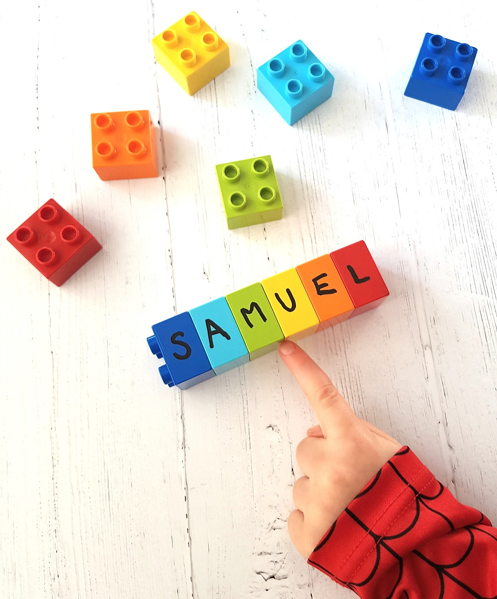 child learning names with duplo