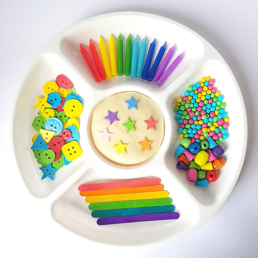 Tray of playdough and rainbow loose parts