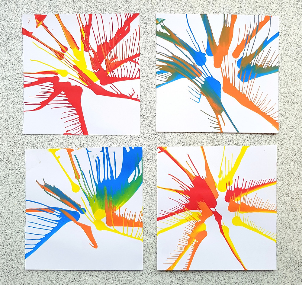 red, yellow, blue and orange spin art