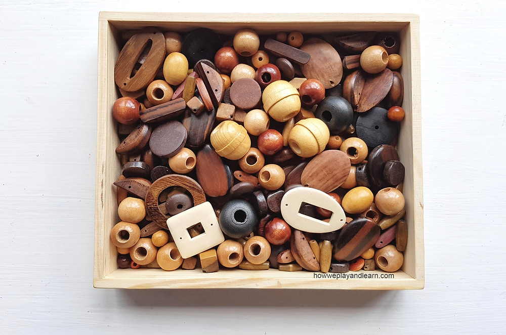 loose parts, tray of wooden beads
