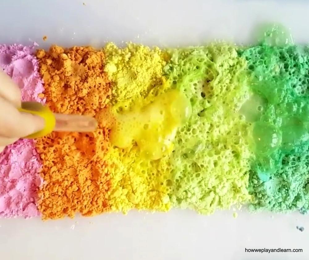 Child's pipette making rainbow powder fizz