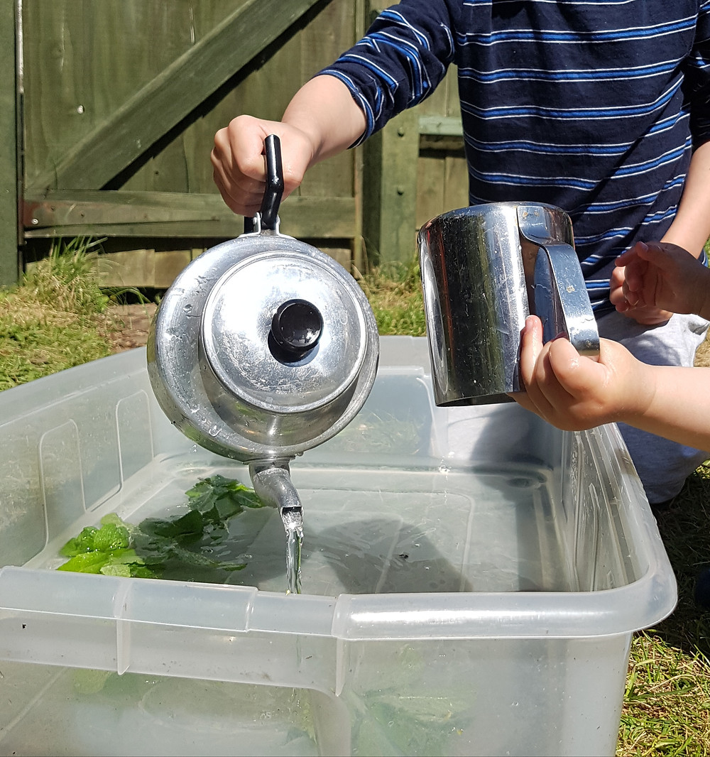 Water play for kids using teapots and jugs