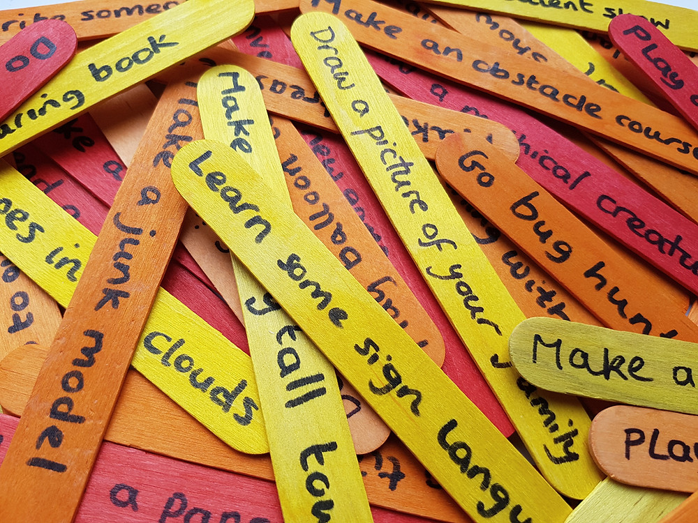 We use lolly sticks with an activity written in permanent marker.