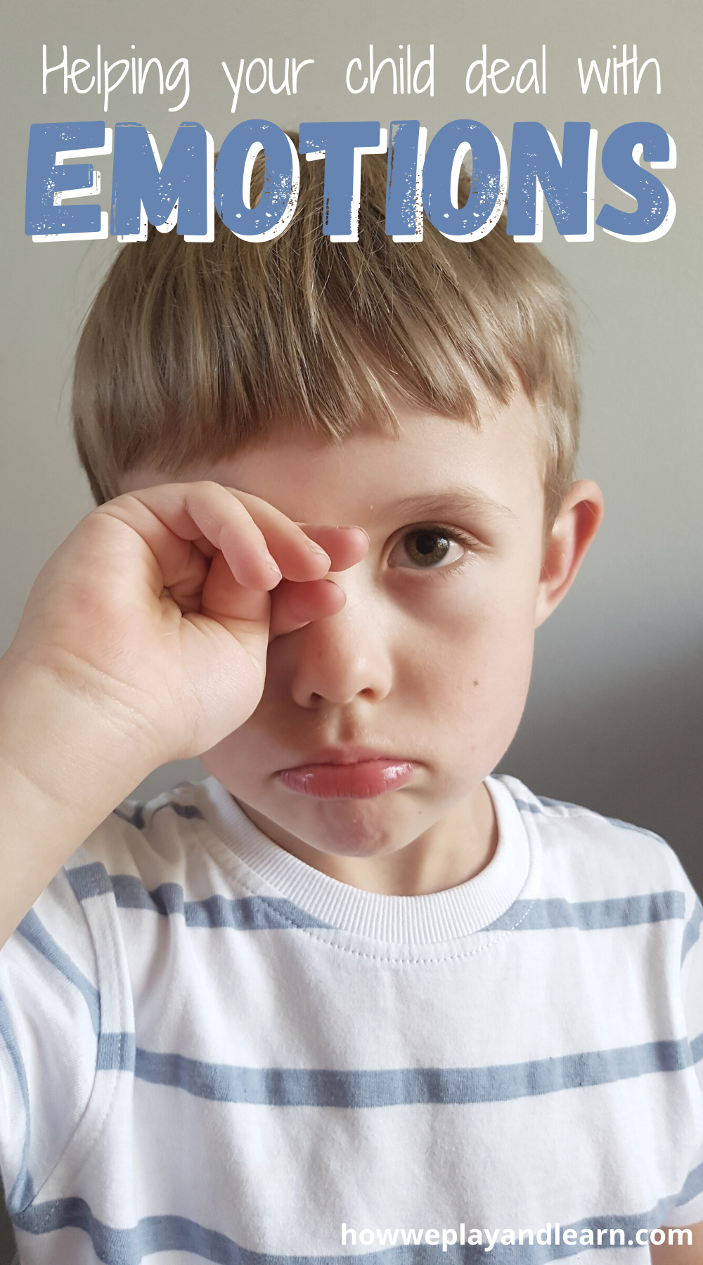 children and emotions - child rubbing eye sadly