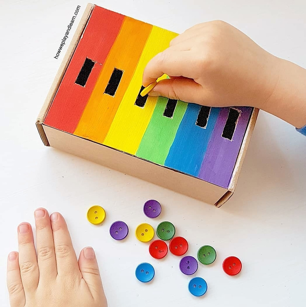 Rainbow buttons posting activity for children