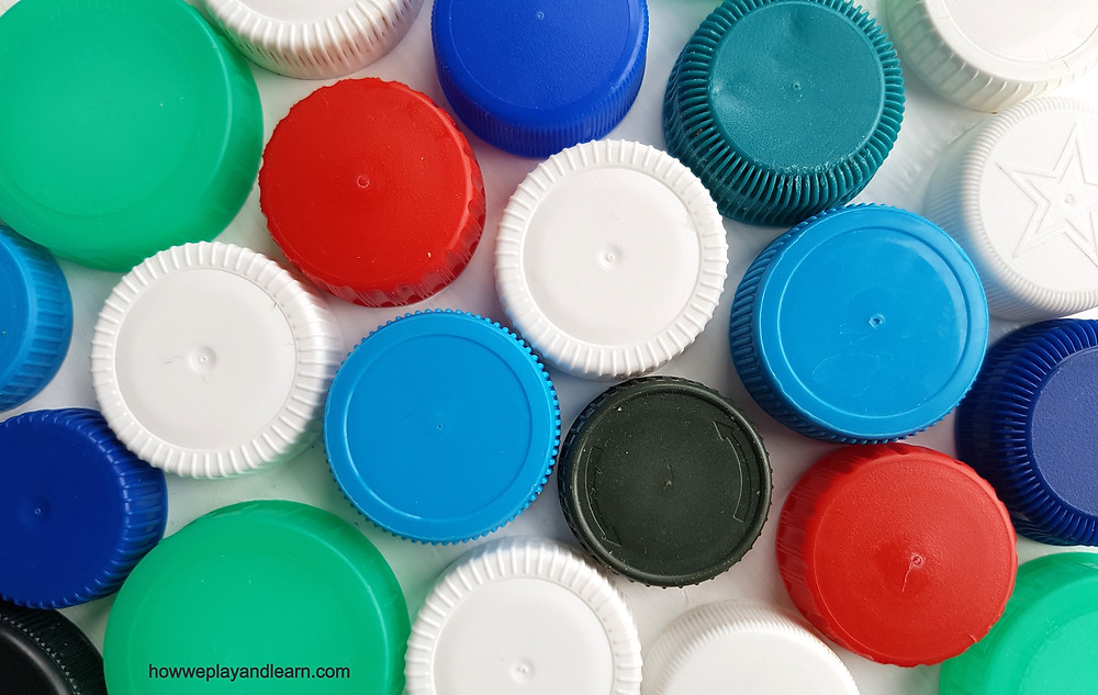 red, blue, green and white milk lids
