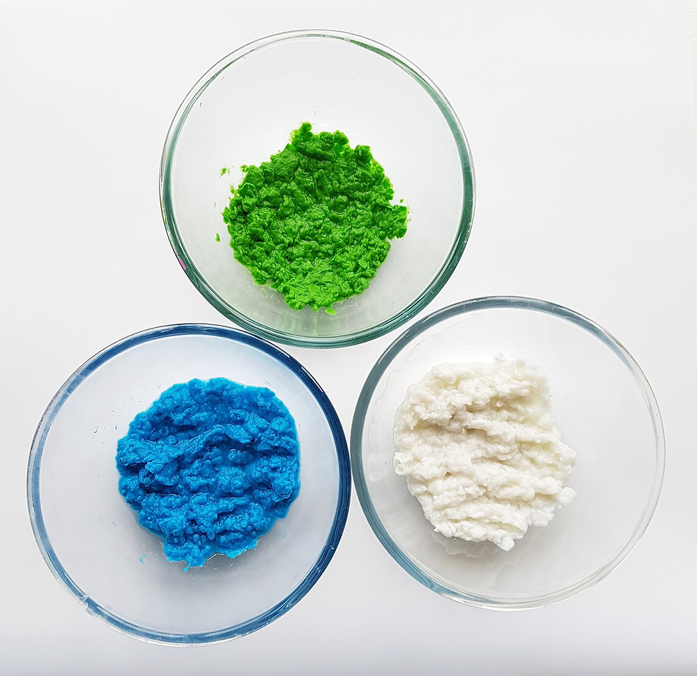 blue, white and green paper pulp