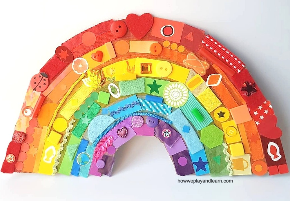 Rainbow collage made of paper, ribbons, buttons, stickers