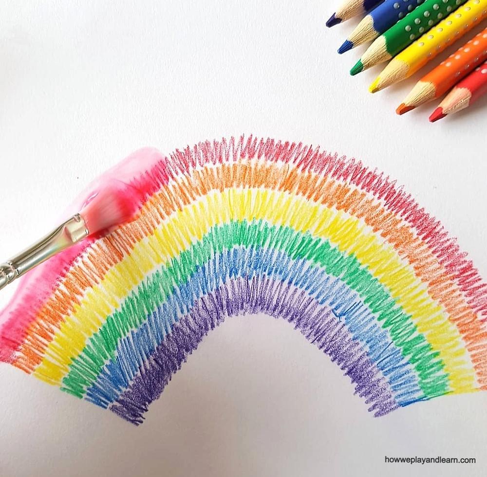 paintbrush and rainbow watercolour pencils