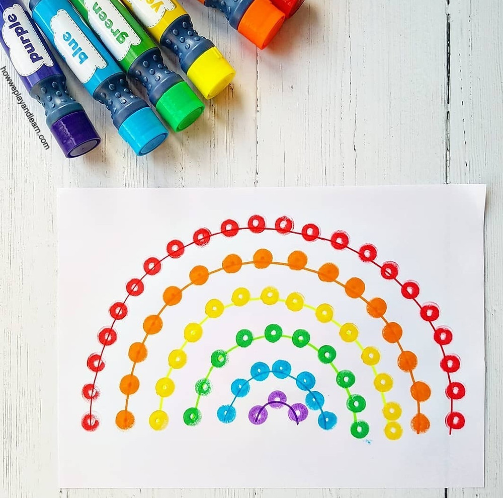 Rainbow on paper made with dot markers