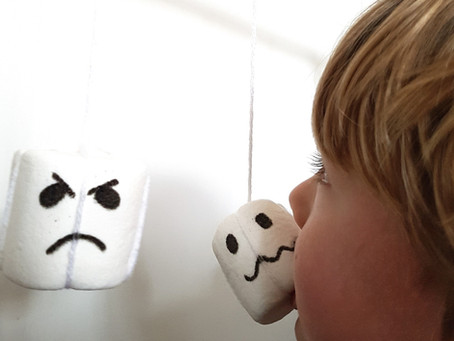 Marshmallow ghosts on a string game