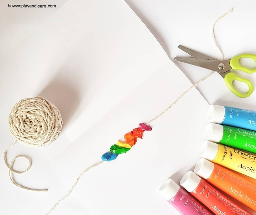 Paint, scissors, string and paper