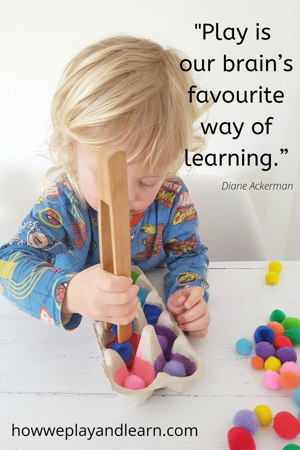 toddler playing with tongs and colourful pompoms