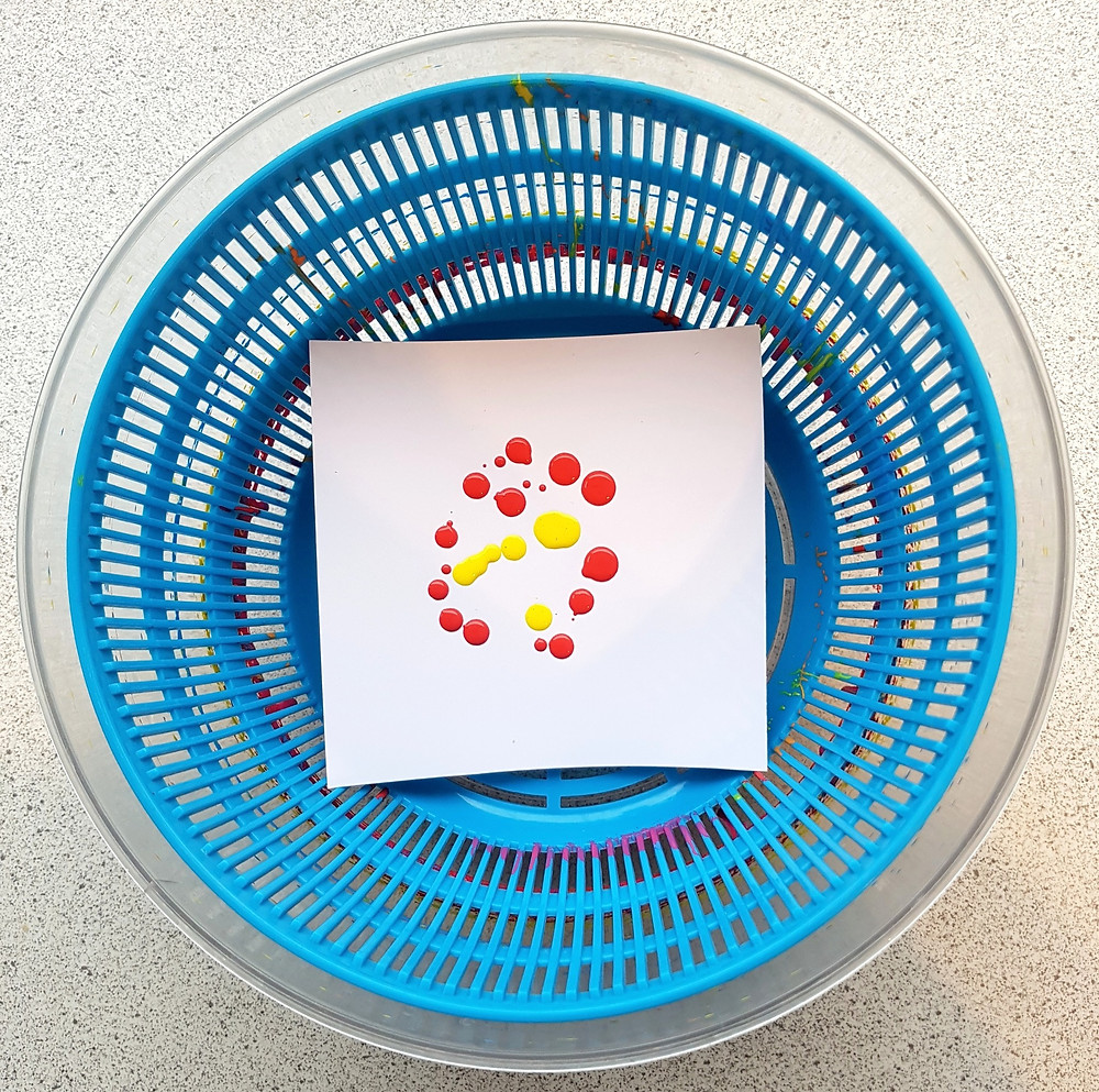paint on paper in salad spinner